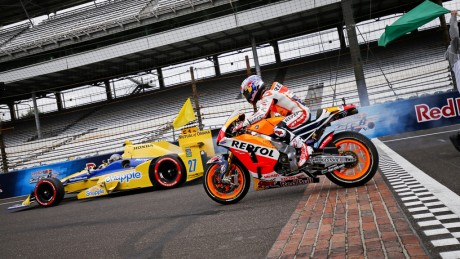 Duel between the 700bhp, 715kg, turbocharged 2.2 litre V6 IndyCar driven by Marco Andretti alongside Dani Pedrosa's 240bhp, 158kg, 1000cc V4 Repsol Honda RC213V MotoGP bike...they completed a lap of the 4.2km Indianapolis Motor Speedway