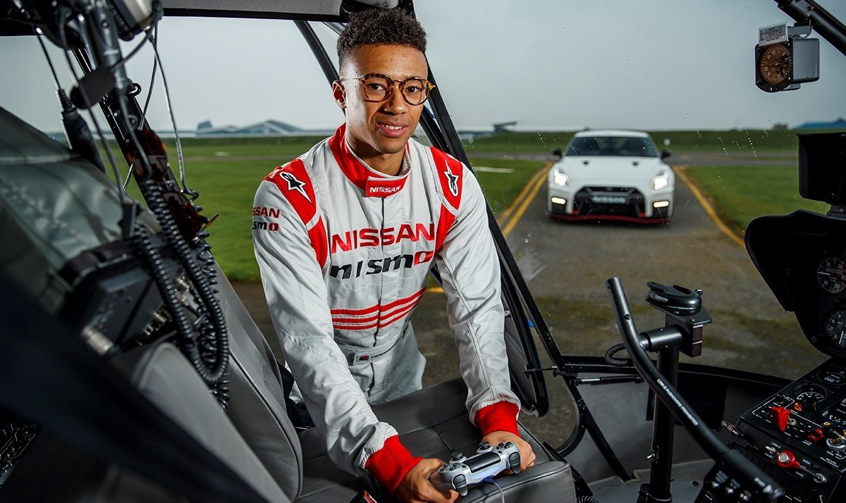 Auto: NISMO driver Jann Mardenborough takes remote control 130mph lap around Silverstone from a helicopter