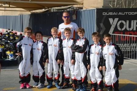 Team coach Nacho Girona with Sodi Racing Academy drivers