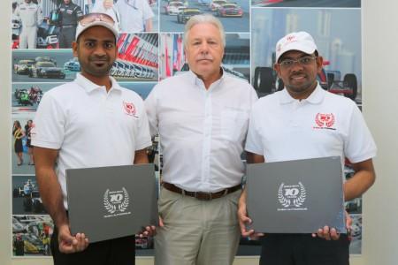 Dubai Autodrome general manager Richard Birch with marshals Abdul Azeez (left) and Shabbir Saifuddin (right)