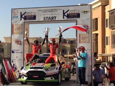 Kuwaiti driver Salah bin Eidan celebrates finishing last year's Kuwait Rally