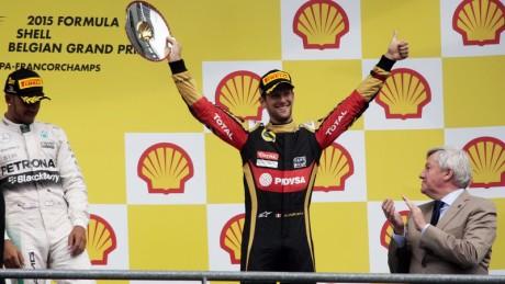 Romain Grosjean Lotus F1 Team celebrates his third position on the podium. Belgium.